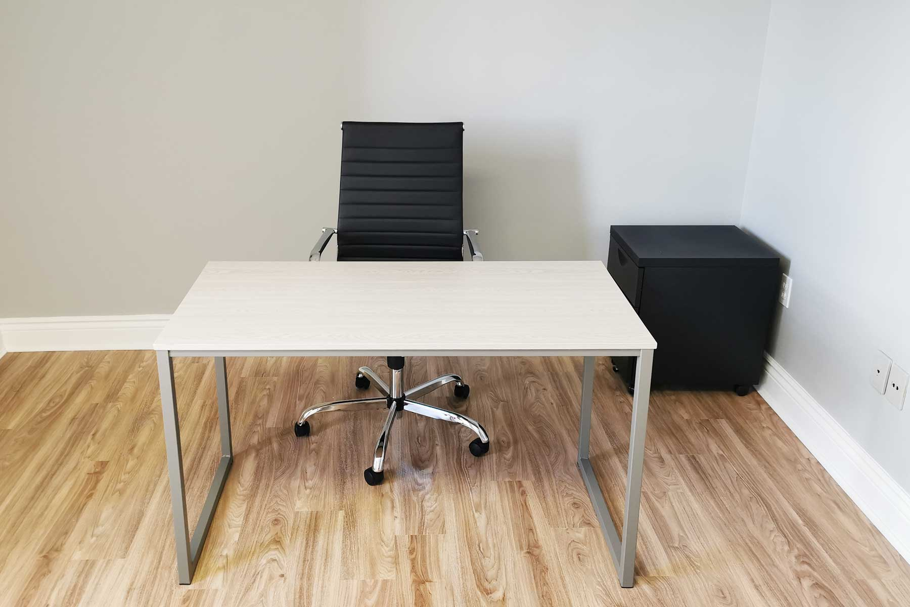 Agora Office Space - White Desks and black leather chairs